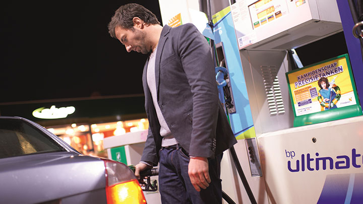 man putting gas in his car